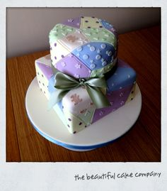 Patchwork cake - A 1st birthday cake for my baby boy based on Zoe Clark's design in her book 'cake decorating at home' . i did the top tier first and realised I should've used flower paste for the patterns rather than sugar paste. but other than that I am pleased with how it all looks.