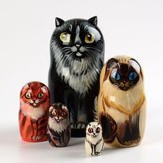 This cute handmade cat nesting doll stands about 6 1/2 inches tall and has a diameter of about 3 inches. There are 5 cats total, each with their own vibrant color. The largest cat features three-dimensional ears and a signature from the Russian artist. This kitty-cat nesting doll would be a wonderful gift for any cat lover! Gloss finished and ready to ship! $72.99