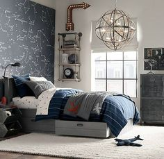 navy and grey bedding with a plane print