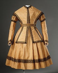 A wonderful girl's dress and pelerine cape made in England circa 1869.