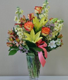 orange and yellow flowers including roses, lilies, stock, alstromeria and more  #Riversideflowers #Flowersriversideca #Riversidecaflowers #Flowers #Florist #Flowersriverside #Riversideflowershop