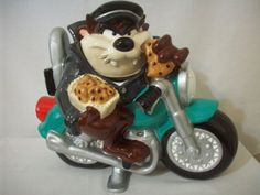 Tasmanian Devil Motorcycle Bike With Taz License Plate Cookie Jar #C1303. MORE PICTURES BELOW. No Box. Looney Tones. Taz is sitting on his motorcycle and wearing his black leather jacket