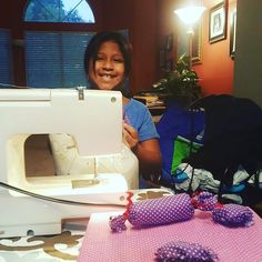 Teaching neice Maya how to sew is fun. We are designing rad pillows for the new Barbie bed! #polkadotsrule #rickrack #textiles