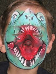 one pinner wrote: T-Rex face paint - so cool. it took a while for me to see the kid's face!