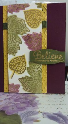Stampin Up LIghthearted Leaves gold embossed and reversed masked leaves using 2014- 2015 in colors blackberry bliss. hello honey, and mossy meadow. Mossy meadow ribbon and boho chic embossing folder sponged lightly with mossy meadow. Believe sentiment from the lighthearted leaves stamp set embossed in gold and die cut with project life cards and labels framelit dies. Link provided for reverse masking tutorial by keanencreations