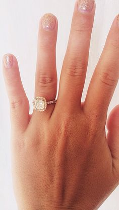 Rose gold 1.5 carat cushion cut diamond engagement ring. Fabri Jewelers in Bellevue Square.