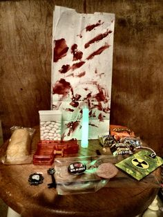 Our zombie party favors included tic tacs for pills, one zombie infection tag, a small water gun, a zombie button, one stretchy brain and various stickers and candy, including a Twinkie.  The bags were simple sandwich bags with red paint smeared across.