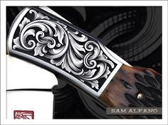 "Sam Alfano's clean borders, balanced design, and pristine surface make this knife engraving look ""finished""."