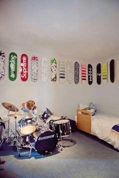 rock & roll room- Many a child dreams of a bedroom like this, drum kit and all... so rad!