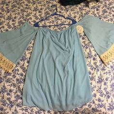 Blue Cold Shoulder Dress Brand new, never worn dress that I bought online from Entourage. The sleeves start right under the armpit, so you can show your shoulders off One of the rubber hanger straps ripped, but there is no damage to the dress! NO TRADES. Peach Love California Dresses