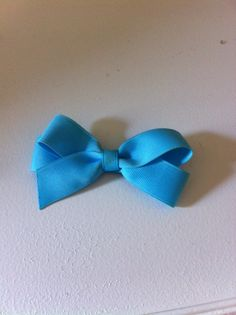 Bow costs $3.00 made by Traci Torrenti size is small