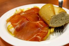 Huevos Rotos con Jamón (Fried eggs and ham over homemade french fires) a classic in Madrid that showcases the simplicity of traditional Spanish cuisine.
