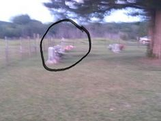 Ghost of women in witches cemetery... blurry ass photo with no story or description? I call bullshit.... just looks like another tombstone to me.