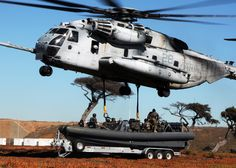 USMC_CH-53_helicopter_conducting_a_maritime_extraction_air_transportation_system_(MEATS)_on_a_RHIB_from_Special_Boat_Team_(SBT)_12.jpg 2,100×1,500 pixels