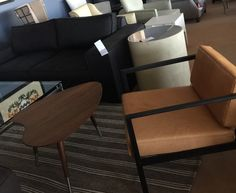 Charcoal sofa. Tan wing chair and American walnut coffee table from coco republic
