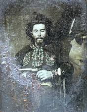 """William T. """"Bloody Bill"""" Anderson in a posed photo after he was dead.  2 of Anderson's pistols were presented to Samuel P. Cox at the time, and when Anderson's brother demanded their return after the Civil War, Cox refused, which set in motion the events that led to the death of John Sheets and the identification of Jesse & Frank James as criminals."""