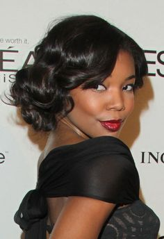 Gabrielle Union smoldering in a pinup do and red lip