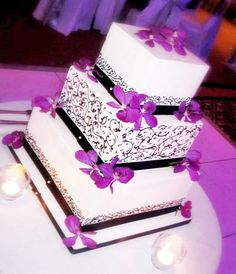 Google Image Result for http://www.fiftyflowers.com/site_files/FiftyFlowers/Image/Testimonials/tstm_652_5899_purple-orchids-cake.jpg