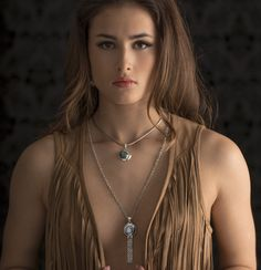 Moonstone Tassel Necklace handcrafted in Sterling Silver with Rainbow Moonstone set in a Silver Sun motif with a chain tassel. Handcrafted in Bali by Bluemoonstone Creations.