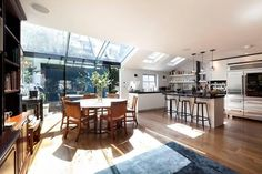 Open plan kitchen dining room / glass walls connected to glass roof. stunning and stunningly expensive! Open Plan Kitchen Dining, Open Plan Living, Nice Kitchen, Tufted Dining Chairs, Interior Decorating, Interior Design, Glass Roof, Planer, Living Spaces