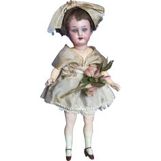 Isn't she just the cutest little thing? Little Missy is a Wonderful 7 inch Bisque head Flapper doll made in the early part of the 20th century by