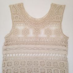 "HP Sundance crochet lace sleeveless tunic top Lovely boho-chic crochet lace tank from the Sundance store in Denver (affiliate of the Sundance catalogue). Sheer and needs a tank top underneath. Tunic length. I removed the tag since I didn't like that it could be seen through the lace. Beautiful, high quality lace. Length measures approx. 31"". Bust measures approx. 16"" laying flat. Sundance Tops Tunics"