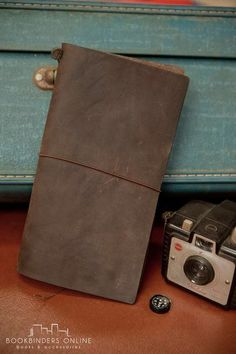 Box Brownie and Brown leather Midori Travelers notebook. Bookbinders Online.