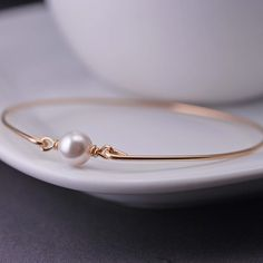 Gold Bangle Bracelet  White Pearl Bracelet by georgiedesigns, $36.00 - They have petite sizes!
