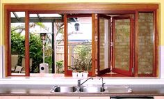 bifold windows over sink.  Think I prefer this step up so that sink is seperate from bar.