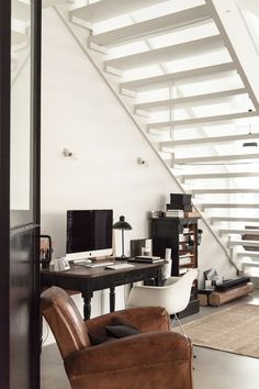 Office / work space under the stairs. A former factory becomes a fabulous family home. Credit: Petra Reger / Wertvoll Fotografie.