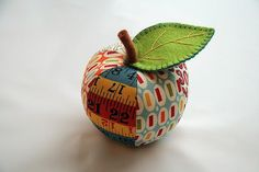 Cute apple pincushion. I love the mix of fabrics.