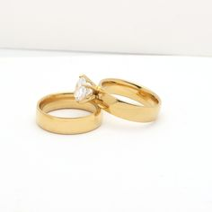 http://gemdivine.com/new-gold-color-white-8mm-zircon-stainless-steel-anniversary-wedding-rings-for-women-jewelry/