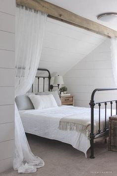 This cozy sleeping nook was created by adding a faux wood beam and lace curtains over the bed, and the results are amazing! See how to do this project in your home at LoveGrowsWild.com: