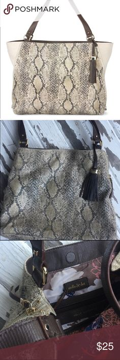 """Stella & Dot The Switch Snakeskin Purse I bought this from a fellow Posher, and ended up finding a different bag, so I have never used it personally.  This last picture shows some WEAR on the side where it rubbed up against. Other than the wear, the rest of it is in great shape! 18""""L X 13""""H X 4"""" D Stella & Dot Bags Shoulder Bags"""