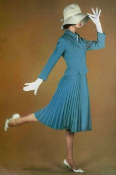 1962 Balmain suit dress outfit skirt pleated jacket knee length white hat gloves shoes color photo print ad model vintage fashion designer casual day wear 60s era