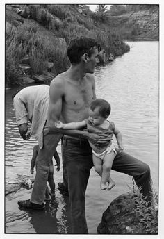 Two men with their babies at a river. . From Duke Digital Collections. Collection: William Gedney Photographs and Writings.