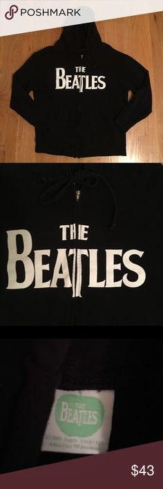 "The Beatles Zip Up Hoodie Black EUC Sz Large L The Beatles Zip Up Black Hoodie Sz. L in Excellent Used Condition.  Measurements  Length(from top of shoulder to bottom seam) 26.5"" Sleeve Length- 22"" Chest(from pit to pit) 24"" The Beatles Sweaters Zip Up"