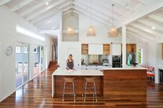 White Wood with clerestory windows exposed beams exposed joists exposed roof structure high ceiling island L shape island natural light neutral colors open plan living open Raked Ceiling, Timber Ceiling, White Ceiling, Timber Flooring, Plywood Ceiling, Timber Panelling, Timber Kitchen, Kitchen Benches, Kitchen Flooring