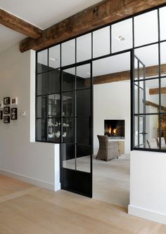 glass wall room divider . hot rolled steel doors and barn beams