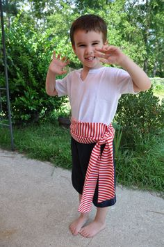 easy pirate costume inspiration... But a rufflier shirt and tight black pants and tall black boots.
