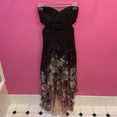 High low strapless dress with cutouts Strapless flowy high low dress with black length underneath, flower petal type pattern different shades of purple and black. Cut outs on sides at top of dress, size XS and worn once! Arden B Dresses High Low