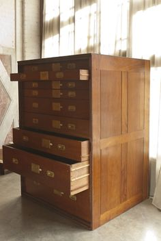 Solid mahogany plan chest units with graduated drawers. Recently salvaged from a Kensington museum.