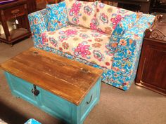 Silk patchwork sofa with an old trunk coffee table