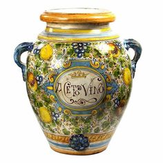 'Tuscania' is the Latin name for the Italian Tuscany region, cradle of art and culture, place of glamour and beauty.This green-toned pattern is an old majolica design that evokes the rich colors of the Tuscan landscape. Italian Pottery, Pottery Painting, Earthenware, Urn, Ceramic Pottery, Food Storage, Tuscany, Safe Food, Mason Jars