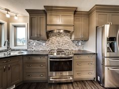 Greige Cabinets, Stainless Steel Appliances