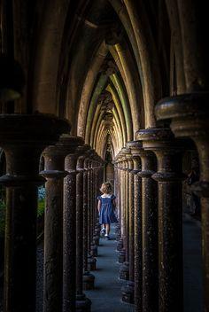 Through the cloister columns, Mont Saint-Michel Abbey / Normandy...