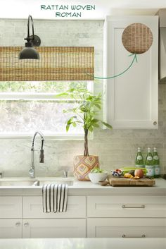 organic white caesarstone countertop and roman shade