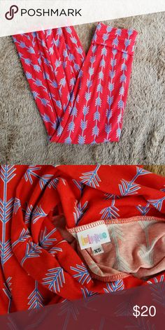 Lularoe maxi Brand: Lularoe  Size: extra small, fits a size 2-6 in my opinion Color: red with blue arrows outlined in white. Can be folded over. Or worn as a dress. Cute maxi skirt with a white top and jean jacket.  Worn a few times. Washed in cold water on delicate cycle, hung dry. Hanging picture is not folded over at the waist. LuLaRoe Skirts Maxi