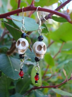 Costume jewelry earrings...skull beads, faceted black & red glass beads.  Handmade by me, Jeanne Orsini.