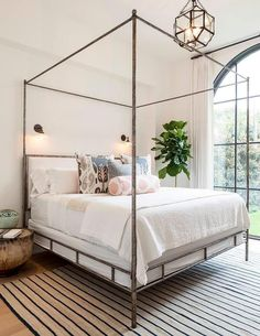 Chic bedroom features a metal canopy bed Oly Studio Marco Bed dressed in soft white bedding and pink and gray ikat pillows as well as a pink ikat bolster ... & 5 Tips for Creating a Master Bedroom He Will Love | Bedroom ...